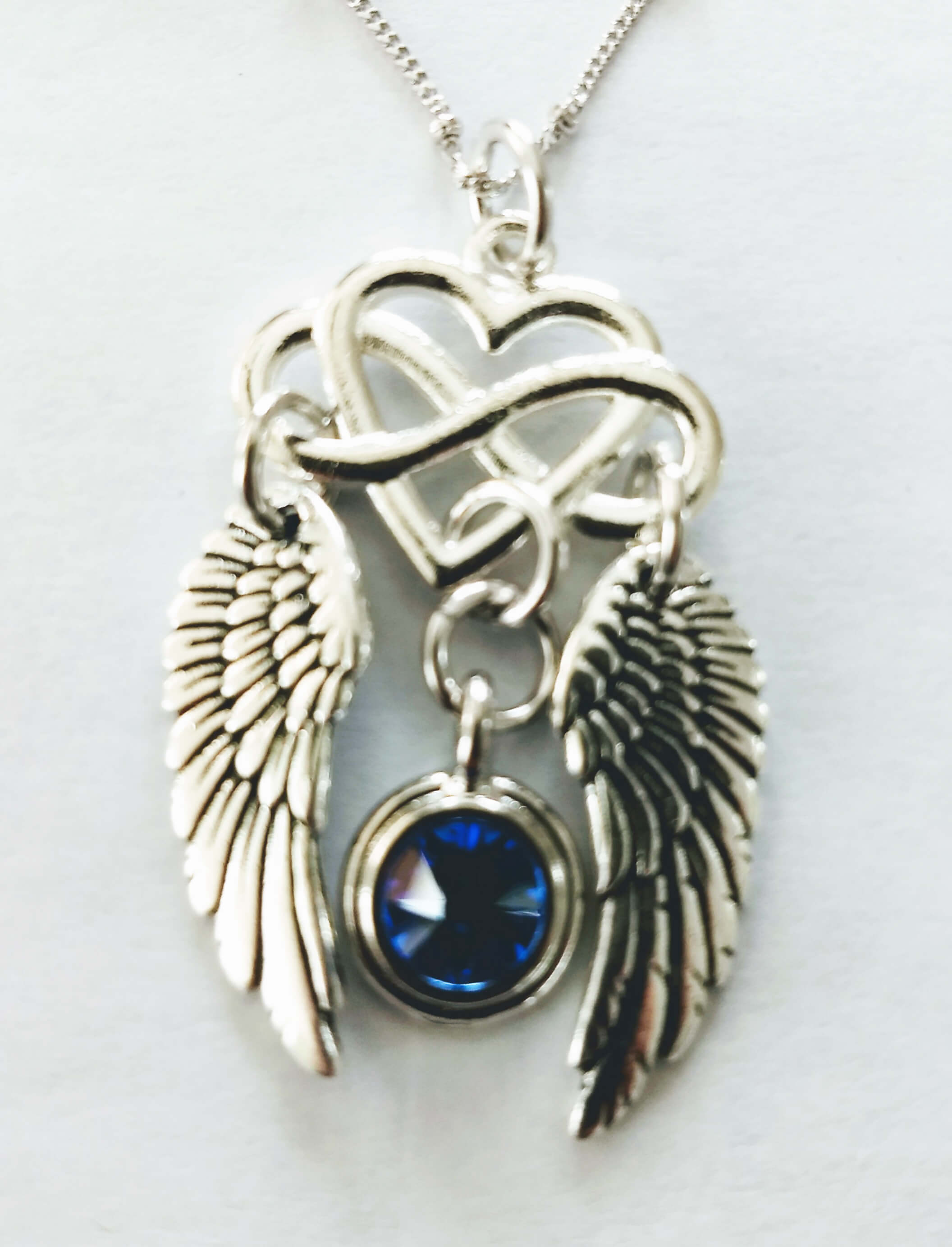 https://lorirae.com/wp-content/uploads/2019/04/Infinity-heart-wings-necklace4.jpg
