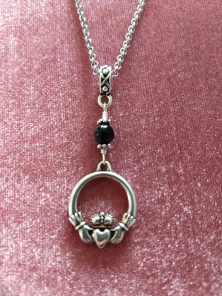 "claddaugh and onyx pendant on 22"" steel rolo chain"