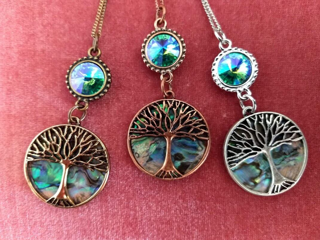 https://lorirae.com/wp-content/uploads/2020/05/Abalone-tree-of-Life-necklaces--scaled-e1588786002646.jpg